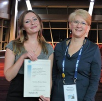 Christine Kleinert receiving her ECR Best Poster Award from Kate Loveland