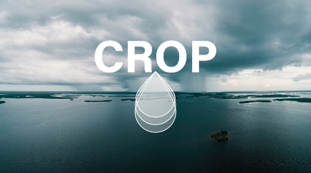 You see a heavily rained landscap and the crop logo in white
