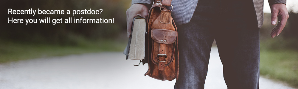 Slider: Photo which shows a person with a shoulder bag standing on an open street. Inscription: Recently became a postdoc? Here you will get all information!
